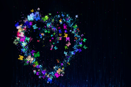 Heart made of multi-colored butterflies, stars and dots