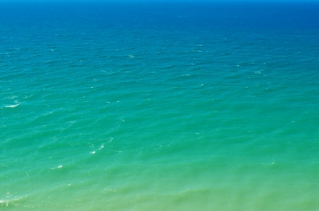depending: The sea changes colors depending on the depth Stock Photo