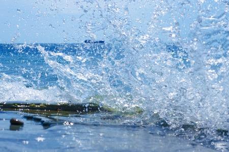 Coastal transparent seaocean crashing wave with foam on its top
