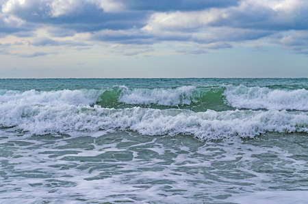 A strong wind rolls the waves to the shore on the Black sea. 免版税图像