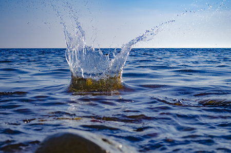 Splashing wave on the Black sea in the day. Imagens