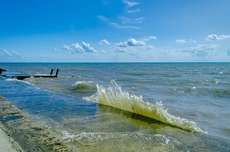 Splashing wave on the Black sea in the day.
