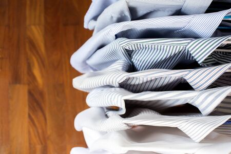 Men shirts hanging on rack in a row, Top view Zdjęcie Seryjne