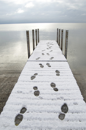 going nowhere: Footprints In Snow On Dock