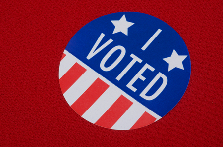 voted: I Voted Sticker On Red Background Stock Photo