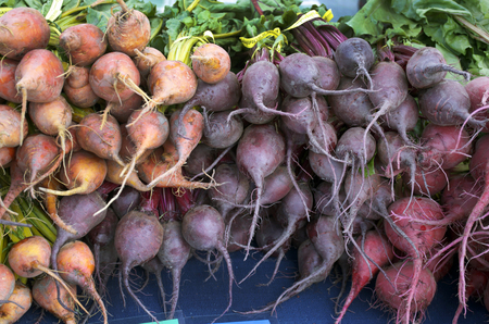 Multicolored Organic Beets Stacked Symmetrically With Roots Showing Stock Photo