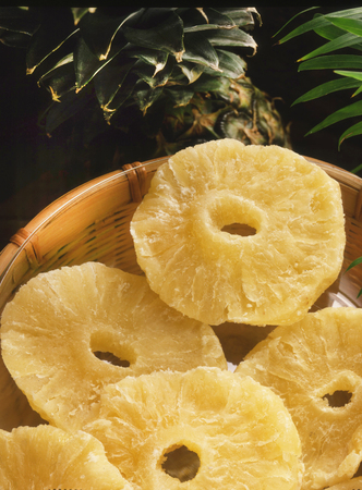Dried Pineapple Slices On Bamboo Plate