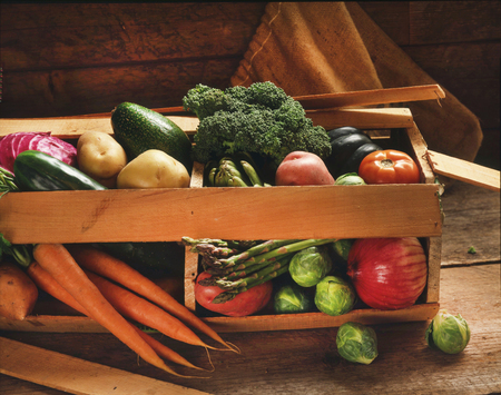 Various Raw Organic Vegetables Busting Out of a Wooden Crate