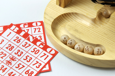 Bingo Scene, Wooden Tray With Wooden Round Bingo Numbers and Playing Cards Stock fotó