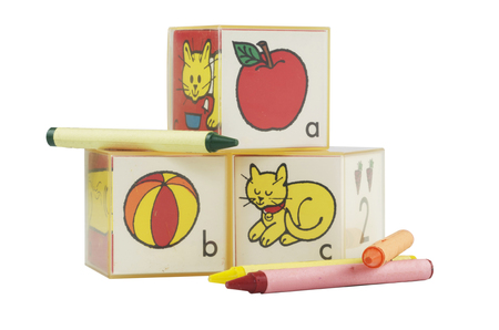ABC Plastic Learning Blocks Stacked with Crayons on White
