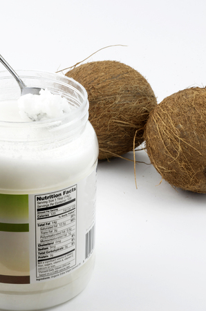 Coconut Oil, Organic, In Jar With Ingredients and Two Fresh Coconuts Фото со стока