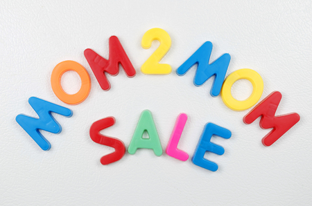 Mom To Mom Sale Sign In Magnetic Bright Colored Letters On Refrigerator Imagens - 76995407