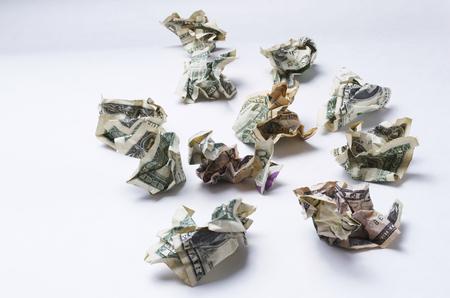 Money Wasted, Money Crumpled On White Background