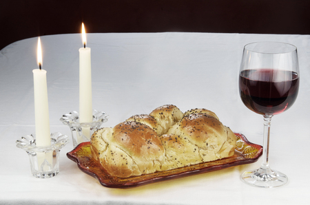 lighted: Shabbat Observance, Challah,Glass of Red Wine,Two Lit Candles