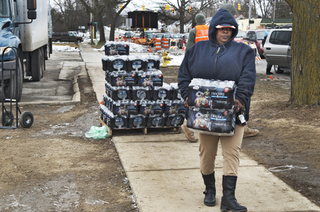 Flint, Michigan January 23, 2016: City of Flint residents coming to get clean bottled water as water crisis continues, January 23, 2016 Downtown Flint, Michigan Editorial