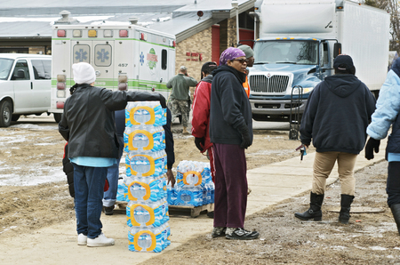 flint: Flint, Michigan January 23, 2016: National Guard distributing bottled water to Flint residents, January 23, 2016 Downtown Flint, Michigan Editorial