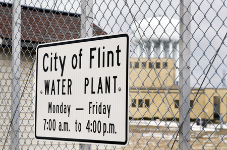 City of Flint Water Plant Sign on Chain Link Fencing 版權商用圖片