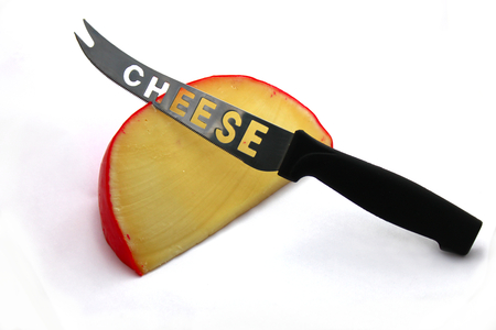 edam: Edam cheese and knife on white