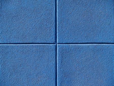 powerpoint: Cuatro plazas azul en una pared de concreto, el fondo de power point.