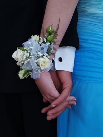 cuff link: White rose wrist corsage with white ribbon and babies breath.