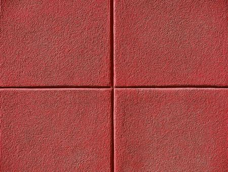 Four red squares on a concrete wall, powerpoint background and copy space.    photo