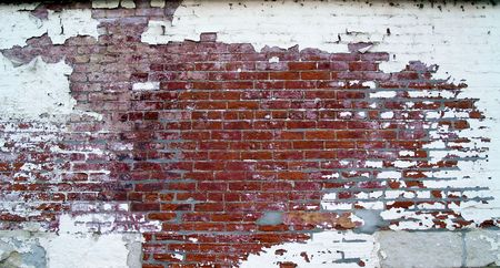 Weathered brick wall on the back of an old historic building. Standard-Bild