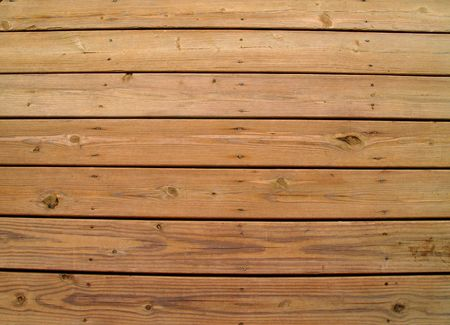 treated board: Wooden slats on a weathered wooden deck.