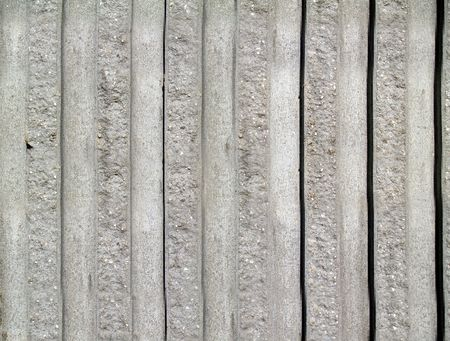 grooved: Rough textured concrete exterior striped wall with a vertical pattern.