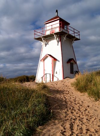 Red and white lighthouse on Prince Edward Island, Canada.      photo
