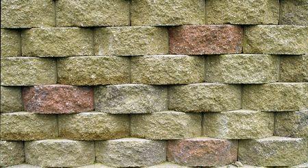 retaining: Multi-colored blocks on a retaining wall.