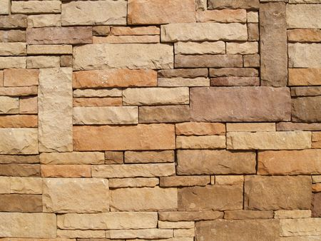 Multi-colored, sized and layered exterior stone wall.          Stock Photo - 4424898