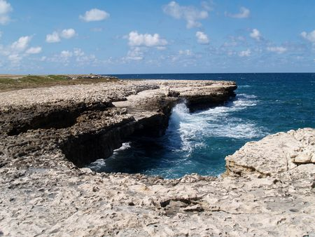 lesser: Devils Bridge at Indian Town Point National Park on Antigua Barbuda in the Caribbean Lesser Antilles West Indies.
