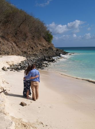 antilles: Couple standing on Frys beach on Antigua Barbuda in the Caribbean Lesser Antilles West Indies.        Stock Photo