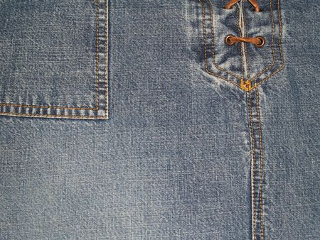 Copy Space on a Close-up view of denim pants or skirt with laces up the front and pocket.      photo