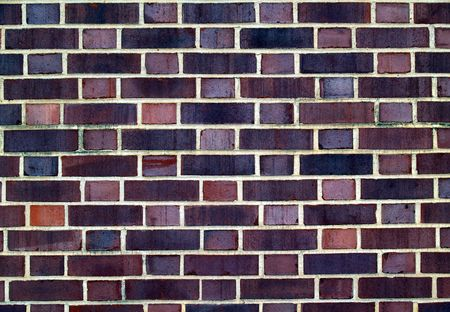 Old brick  exterior wall with Red and black duo-sized bricks.       photo