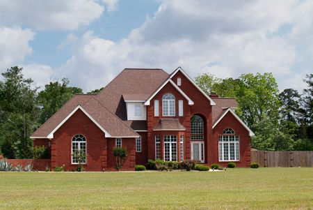 garage on house: Two story residential home with brick facade.        Stock Photo