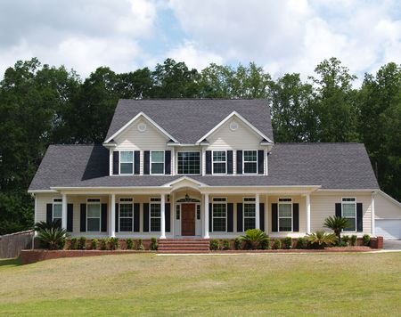 single story: Two story residential home with with board siding on the facade.     Stock Photo