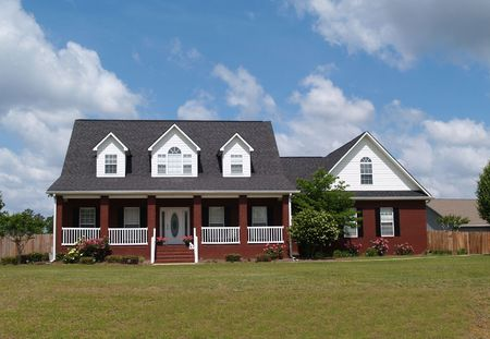 single story: Two story residential home with brick facade.       Stock Photo