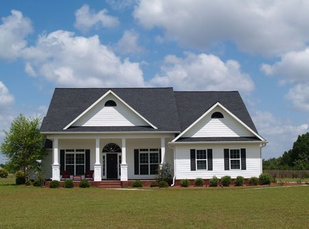 One story residential home with board siding on the facade.    Standard-Bild