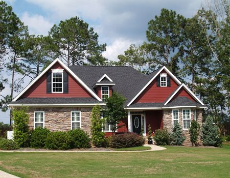 Two story residential home with both stone and board siding on the facade.  Standard-Bild