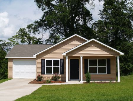 One story residential low income home with vinyl siding on the facade.      Stock Photo