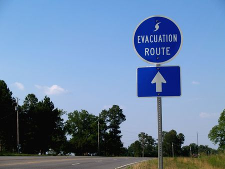 forewarning: Blue hurricane evacuation route sign along a highway.       Stock Photo
