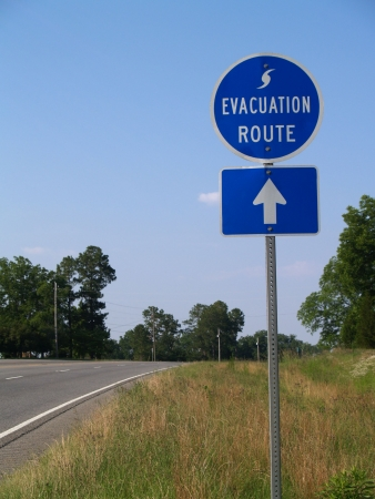 forewarning: Blue hurricane evacuation route sign along a highway.