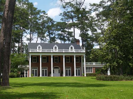 Two story residential, historical, south GA home with brick facade and white columns.Two story residential, historical, south GA home with brick facade and white columns.Two story residential, historical, south GA home with brick facade and white colum