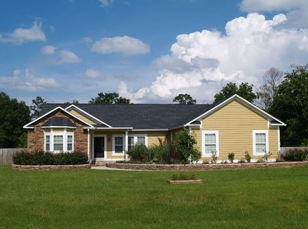 single family home: One story residential home with vinyl siding and brick or stone on the facade.
