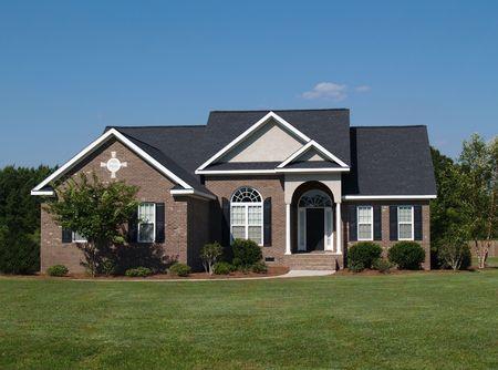 One story new brown brick residential home. Standard-Bild