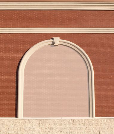 Ornate Roman styled brick wall with curved molding and a reduced opacity brick copy space. Stockfoto