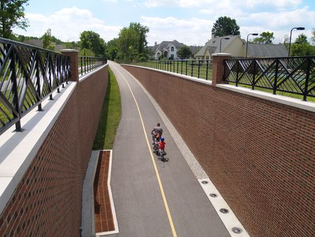 Father and son riding bikes on the Monon Greenway Trail in Carmel, Indiana.