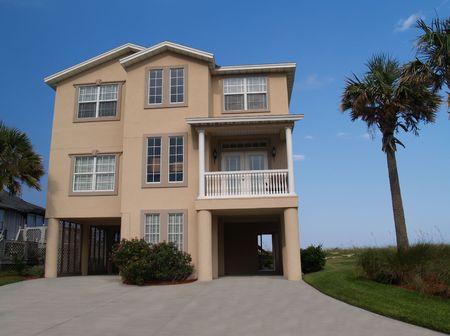 garage on house: Three story beach house found in Florida.