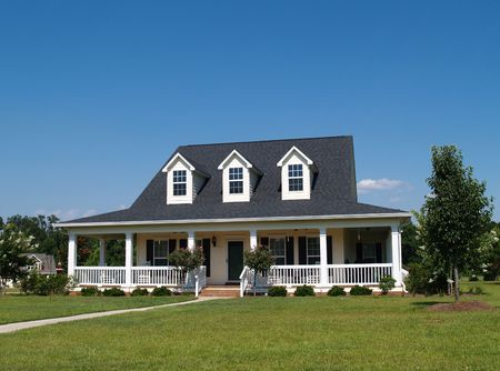 dormer: Two story residential home with vinyl or board siding on the facade.